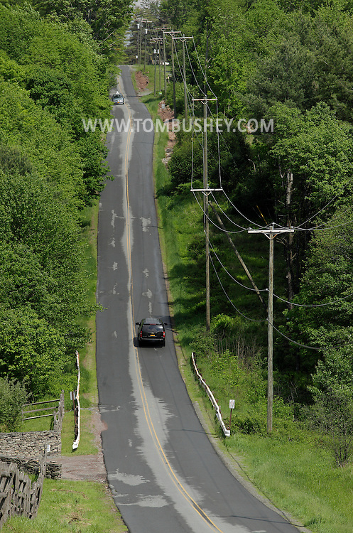 Bethel, New York - Cars drive on rural West Shore Road in Sullivan County on May 28, 2011.