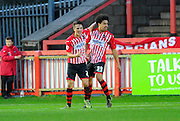 Exeter City's Tom Nichols celebrates the equalising goal with Exeter City's Troy Brown during the Sky Bet League 2 match between Exeter City and Dagenham and Redbridge at St James' Park, Exeter, England on 2 January 2016. Photo by Graham Hunt.