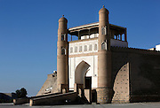 General view of the main gate,  Ark Fortress, 5th century, Bukhara, Uzbekistan, pictured on July 11, 2010 in the afternoon. Initially a massive earthen fortification built in the 5th century, the Ark remained Bukhara's fortress until it was badly damaged in 1920 when the city was besieged by the Bolsheviks. The towers framing the gateway date from the 18th century. Bukhara, a city on the Silk Route is about 2500 years old. Its long history is displayed both through the impressive monuments and the overall town planning and architecture. Picture by Manuel Cohen.