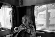 Young girl inside caravan.Ashton Court Festival, Bristol 1995.