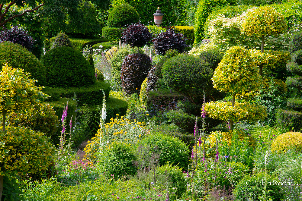 An aerial view of multi-coloured topiary from the Belvedere in the Laskett Gardens, Much Birch, Herefordshire, UK