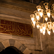A ring of lights inside the Nuruosmaniye Mosque, ornately decorated in Ottomon-Baroque style. Nuruosmaniye Mosque, standing next to Istanbul's Grand Bazaar, was completed in 1755 and was the first and largest mosque to be built in Ottoman Baroque style.
