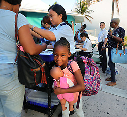 A young evacuee from Freeport, Bahamas, holds a doll before boarding Royal Caribbean's Mariner of the Seas cruise ship after it arrived in Freeport, Bahamas, Saturday, September 7, 2019. The ship delivered 10,000 relief meals and picked up refugees wanting to leave Freeport to go to Nassau after the island was devastated by Hurricane Dorian. Photo by Joe Burbank/Orlando Sentinel/TNS/ABACAPRESS.COM