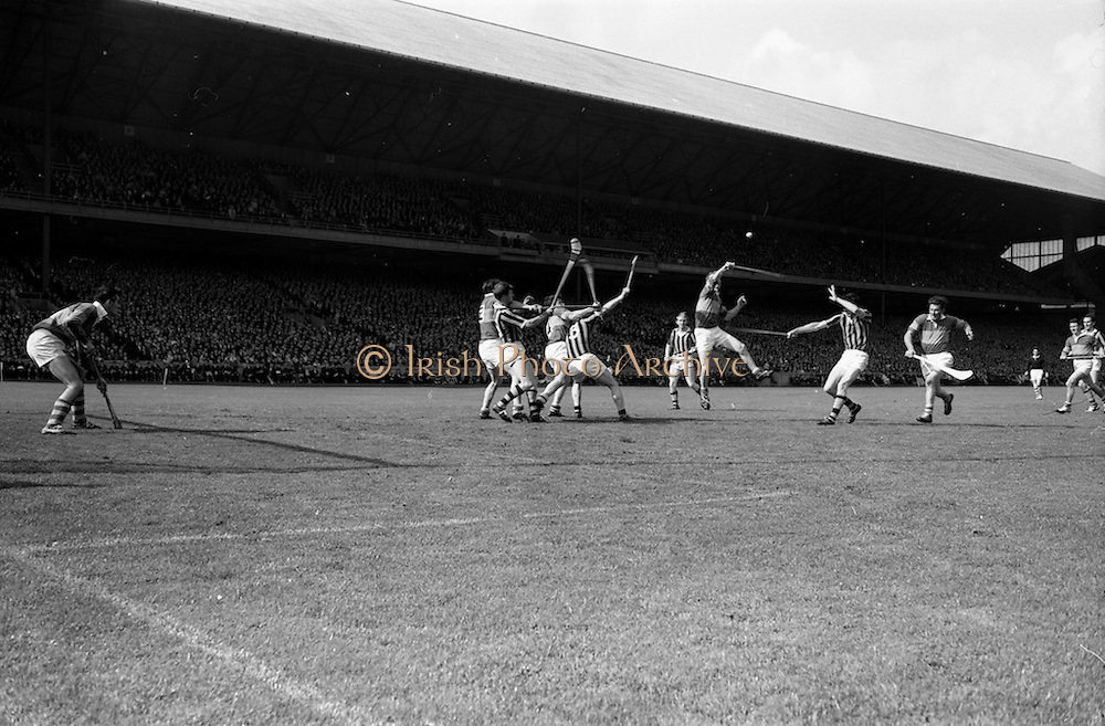 03/09/1967<br /> 09/03/1967<br /> 3 September 1967<br /> All-Ireland Senior Hurling Final: Kilkenny v Tipperary at Croke Park, Dublin.<br /> Tipperary forward, M. Keating (center), tries desperately to score towards the end of the match with the famous Jimmy Doyle (left) coming up for support.