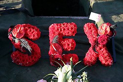 © Licensed to London News Pictures. 09/12/2015. London, UK. Red flowers spelling SEX at the graveside... The funeral of former brothel keeper Cynthia Payne takes place at the South London Crematorium.  In 1980 Cynthia Payne was sentenced to 18 months for running a brothel at her house on Ambleside Avenue in Streatham. It was alleged, at the time, that judges and Members of Parliament were visitors to her establishment. Photo credit: Peter Macdiarmid/LNP
