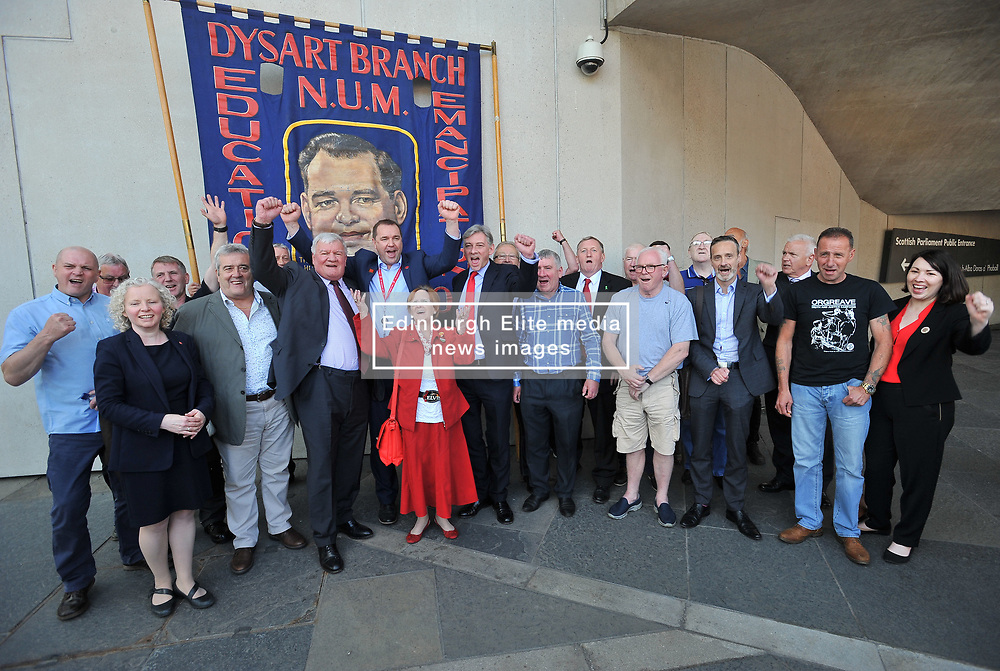 Pictured: Neil Findlay MSP is joined by ex miners and Scottish Labour leader Richard Leonard in celebrating the announcement.<br /> <br /> Justice Secretary Michael Matheson announced and independent inquiry into policing tactics and policy during the 1884/ EEm