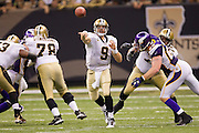 NEW ORLEANS, LA - SEPTEMBER 9:  Drew Brees #9 of the New Orleans Saints throws a pass against the Minnesota Vikings at the Louisiana Superdome on September 9, 2010 in New Orleans, Louisiana.  The Saints defeated the Vikings 14-9.  (Photo by Wesley Hitt/Getty Images) *** Local Caption *** Drew Brees