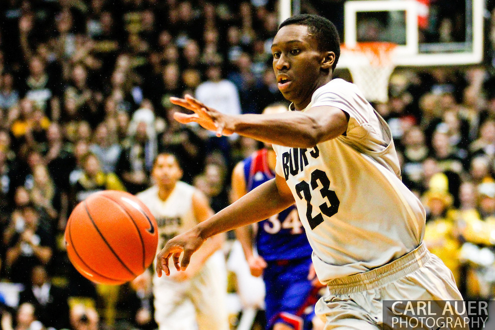 December 7th, 2013:  Colorado Buffaloes freshman guard Jaron Hopkins (23) chases down the ball in the second half of the NCAA Basketball game between the Kansas Jayhawks and the University of Colorado Buffaloes at the Coors Events Center in Boulder, Colorado