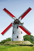 Traditional working Schellemolen windmill with red painted sails at Damme, West Flanders in Belgium