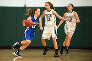 Vergennes' Caroline Johnston (15) tries to dribble then all around Winooski's Riley Corrigan (13) during the girls basketball game between Vergennes and Winooski at Winooski High School on Wednesday night December 9, 2015 in Winooski. (BRIAN JENKINS/for the FREE PRESS)