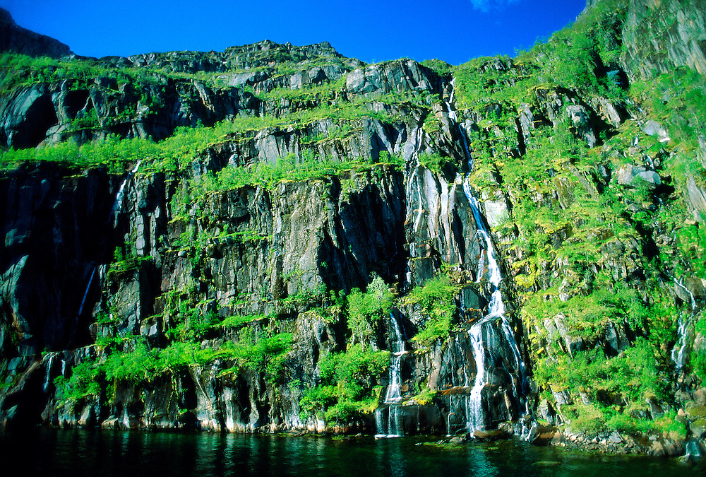 Waterfall in Trollfjord, near Svolvaer, Lofoten Islands, Arctic, Northern Norway