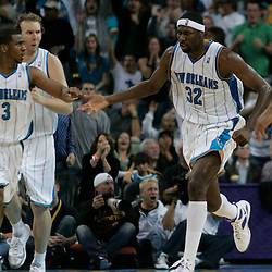 29 March 2009: New Orleans Hornets forward Julian Wright (32) celebrates with teammates after a dunk during a 90-86 victory by the New Orleans Hornets over Southwestern Division rivals the San Antonio Spurs at the New Orleans Arena in New Orleans, Louisiana.