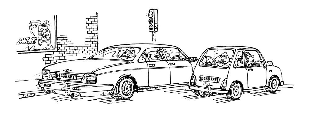 (A Mini and a Jaguar are waiting at traffic lights.  the Mini has a 'Baby on Board' sign on the rear window, while the Jaguar has a sign reading 'Seat on the Board')