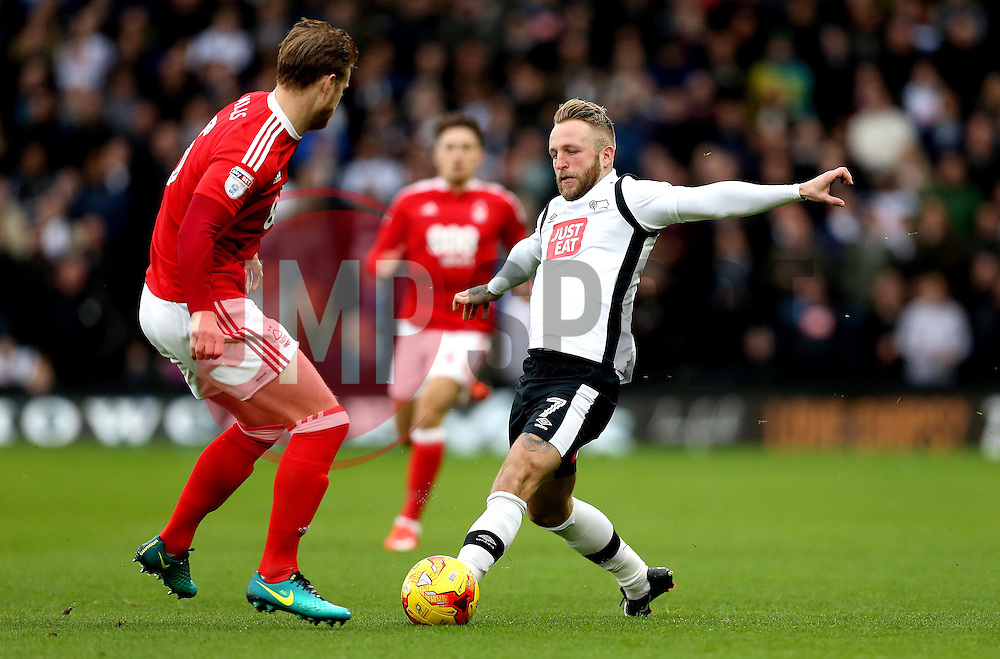 Johnny Russell of Derby County is tackled by Matthew Mills of Nottingham Forest - Mandatory by-line: Robbie Stephenson/JMP - 11/12/2016 - FOOTBALL - iPro Stadium - Derby, England - Derby County v Nottingham Forest - Sky Bet Championship