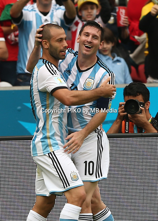 Fifa Soccer World Cup - Brazil 2014 - <br /> NIGERIA  (NGA) Vs. ARGENTINA (ARG) - Group F - Estadio Beira-RioPorto Alegre - Brazil (BRA) - June 25, 2014 <br /> Here Argentine player Lionel Messi celebrating his second goal with the player Javier Mascherano. Scoring the match 2-1<br /> &copy; PikoPress