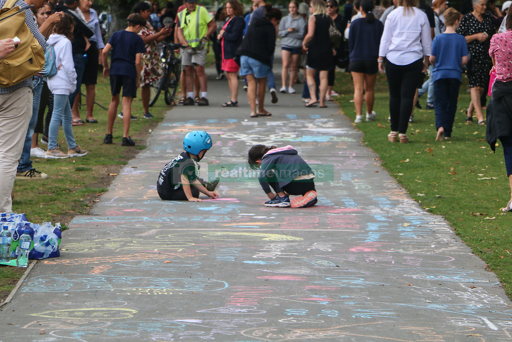 March 16, 2019 - Christchurch, Canterbury, New Zealand - Two children play on a path seemingly oblivious to what the colorful drawings mean, or what has happened during the terror attacks after the Christchurch mosques shooting. Around 50 people has been reportedly killed a terrorist attack onn two Christchurch mosques. (Credit Image: © Adam Bradley/SOPA Images via ZUMA Wire)
