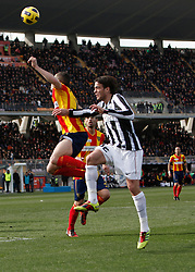 ITALY, Lecce :Matri J Mesbah L during the Serie A match between Lecce and Juventus at Stadio Via del Mare in Lecce on February 20, 2011. .AFP PHOTO / GIOVANNI MARINO