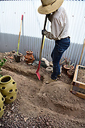 My cistern will be what's called a wet cistern. Meaning that its plumbing will be installed underground. In order to make that happen, careful trenching is required. Here, Madeline shows how it's done.