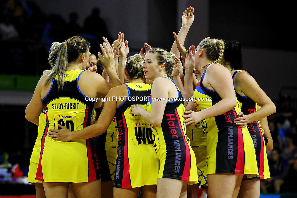 Pulse players get in a team huddle. ANZ Netball Championship, Northern Mystics v Central Pulse, Trusts Stadium, Auckland, New Zealand. Sunday 21st April 2013. Photo: Anthony Au-Yeung / photosport.co.nz