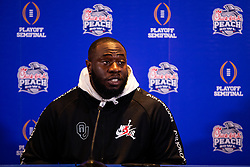 The Oklahoma Sooners defensive lineman Neville Gallimore answers questions from the media at the Omni Hotel on Monday, Dec. 23, 2019, in Atlanta. LSU will face Oklahoma in the 2019 College Football Playoff Semifinal at the Chick-fil-A Peach Bowl. (Jason Parkhurst via Abell Images for the Chick-fil-A Peach Bowl)