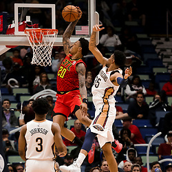 Mar 26, 2019; New Orleans, LA, USA; Atlanta Hawks forward John Collins (20) dunks over New Orleans Pelicans forward Christian Wood (35) during the second half at the Smoothie King Center. Mandatory Credit: Derick E. Hingle-USA TODAY Sports