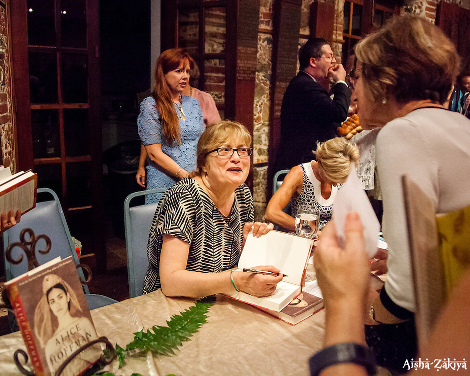 """Author Alice Hoffman signs copies of her latest novel """"The Marriage of Opposites"""", for Mary Kral.    Hoffman's novel tells the story of  Rachel Pomié, mother of Camille Pissarro considered to be the father of Impressionism and a St. Thomas native son.  5 February 2016.  St. Thomas, USVI.  © Aisha-Zakiya Boyd"""