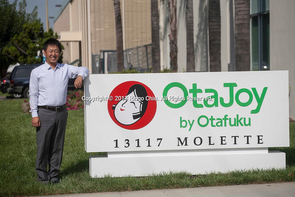 Takamitsu Ozawa of Otafuku Food Inc.. The company has been selling in the U.S. since 1998, all its products imported from Japan. But they will soon open a manufacturing facility to make products locally so they can speed up their response to local customers. (Photo by Ringo Chiu/PHOTOFORMULA.com)