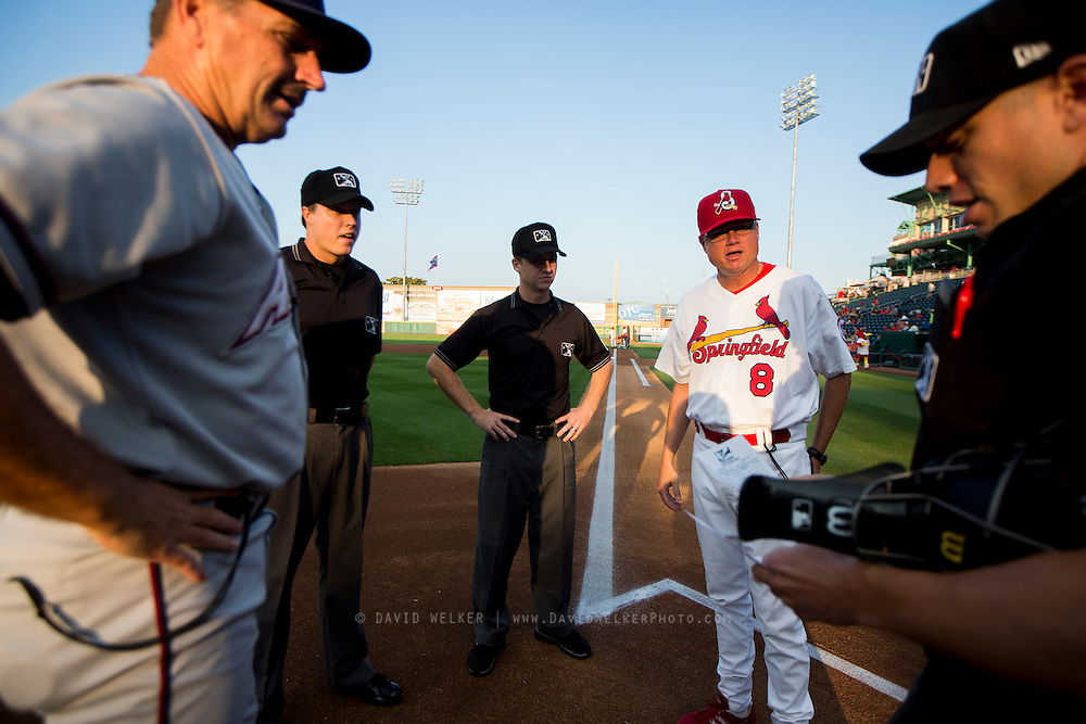 Manager Mike Shildt (8) of the Springfield Cardinals talks with Naturals Manager Brian Poldberg and the umpire crew during a game between the Northwest Arkansas Naturals and Springfield Cardinals at Hammons Field on August 20, 2013 in Springfield, Missouri. (David Welker)