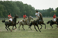"""April 1986, Buenos Aires, Argentina --- A group of men play the Argentine mounted sport """"pato."""" --- Image by © Owen Franken/CORBIS"""