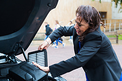 Sylvie Childs, Senior Product Manager at Hyundai UK  removes a particulate filter as  Hyundai UK demonstrates the Hydrogen-powered Nexo that not only produces completely clean emissions but also cleans up the air its engine ingests, thanks to a filtration system developed by scientists at University College London. UCL London, October 17 2018.