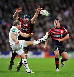 Toulouse replacement Jano Vermaak box kicks the ball after Saracens second row Steve Borthwick looks to charge it down - Photo mandatory by-line: Patrick Khachfe/JMP - Tel: 07966 386802 - 18/10/2013 - SPORT - RUGBY UNION - Wembley Stadium, London - Saracens v Toulouse - Heineken Cup Round 2.