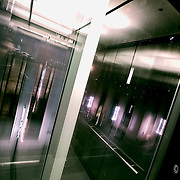 A bit of a reflection of myself in a glass elevator going down, at the downtown library parking garage one summer night in 2009