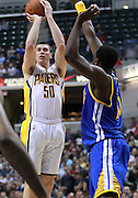 Feb. 28, 2012; Indianapolis, IN, USA; Indiana Pacers power forward Tyler Hansbrough (50) shoots the ball against Golden State Warriors power forward Ekpe Udoh (20) at Bankers Life Fieldhouse. Mandatory credit: Michael Hickey-US PRESSWIRE