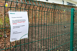 A notice from Hackney Council is attached to a fence surrounding what was once a flourishing vegetable garden in the grounds of Debdale House on the Whiston Estate in Hackney, established by keen gardener Lou Downe, has now been dug up and seeded with grass by council workers after Ms Downe's activities were determined as trespass by Hackney Council.. London, March 08 2019.