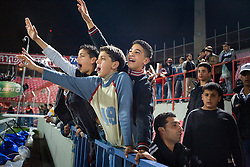 Arab fans call for Abbas Suan at the start of a game with his local team Bnei Sahknin at Bloomfield Stadium, Jaffa, Israel, Jan. 29, 2006. The team has a mixture of Israeli-Arab, Israeli, and foreign players. Suan, an Israeli-Arab, still faces criticism and racism resulting from the unsettled conflict between the Israelis and Palestinians.