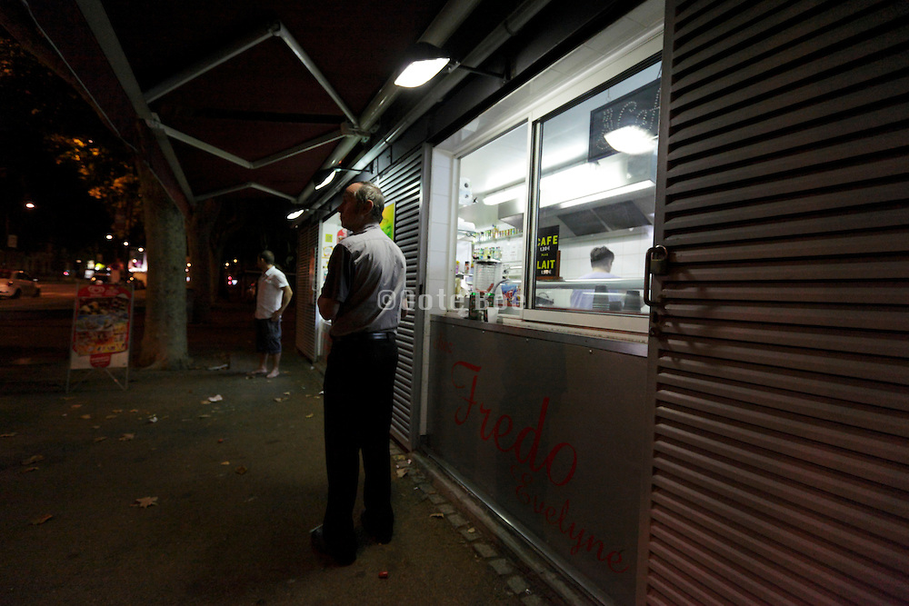 people standing by a snack bar at night