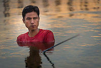 MANDALAY, MYANMAR - CIRCA DECEMBER 2013: Fisherman close the U Bein Bridge in Amarpura