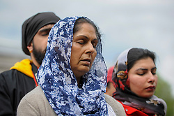 © Licensed to London News Pictures. 29/04/2017. London, UK. Visitors listen to a prayer at the Sikh festival of Vaisakhi taking place in Trafalgar Square and hosted by the Mayor of London.  The festival celebrates the beginning of Sikhism, a collective faith which is practiced by more than 20 million people worldwide.   Photo credit : Stephen Chung/LNP