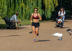 © Licensed to London News Pictures. 20/08/2020. London, UK. Calm after the storm. A runner enjoys the warm sunshine in Hyde Park in Westminster this morning with highs of 25c expected for London and the South East, a day after the UK was battered by Storm Ellen which saw heavy downfalls and high winds. However, weather forecasters have predicted high winds for tomorrow as the UK continues to feel the force of the Atlantic storm. Photo credit: Alex Lentati/LNP