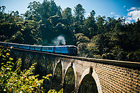 Ella, Sri Lanka -- February 2, 2018: A train makes its way over Nine Arches Bridge.