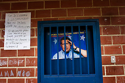 Presidential elections are set for December 3, 2006 in Venezuela.  Hugo Chavez holds a commanding lead in the polls over his nearest opponent, Manuel Rosales.  An oil revenue funded spending splurge on social programs and infrastructure that has kept the poor squarely on Chavez's side.  /// Chavez propaganda on the outside of a Barrio Adentro free health clinic in Coche, a poor slum in Caracas