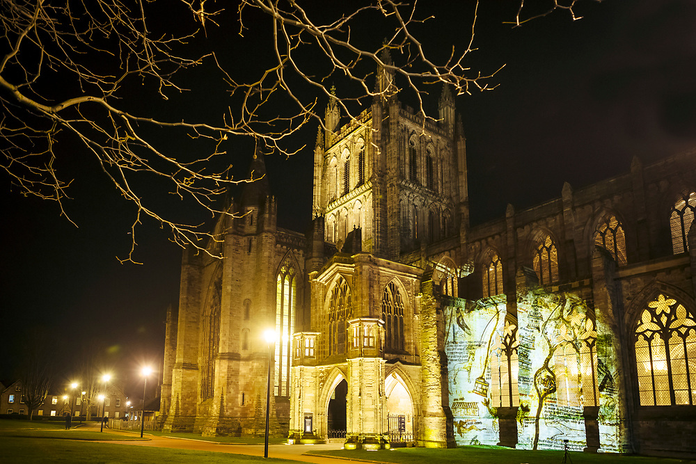 HEREFORD, UK January 23rd 2019 - Image of the Mappa Mundi is projected onto the Hereford Cathedral, United Kingdom