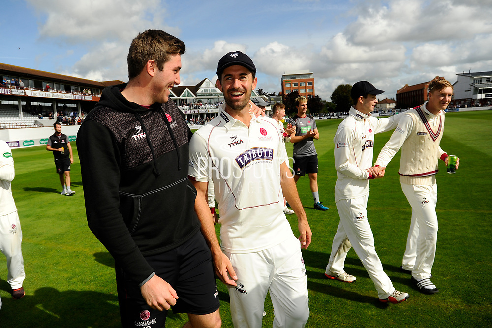 Jamie Overton of Somerset and Tim Groenewald of Somerset on a lap of honour after beating Middlesex to secure survival in Division 1 of the Specsavers County Champ Div 1 match between Somerset County Cricket Club and Middlesex County Cricket Club at the Cooper Associates County Ground, Taunton, United Kingdom on 28 September 2017. Photo by Graham Hunt.