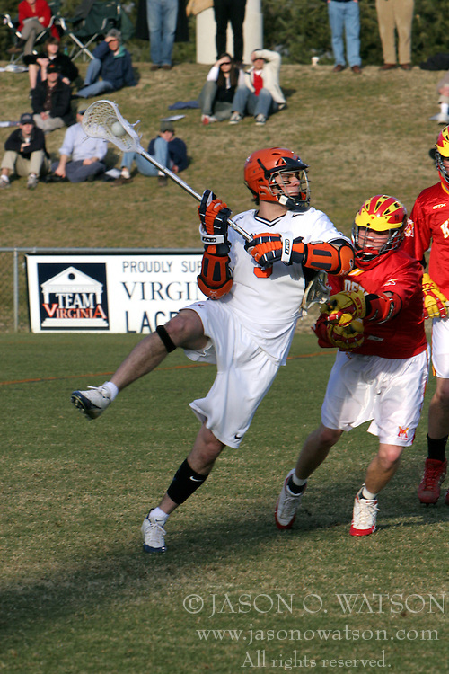 Steve Giannone (5) shooting one of his two goals on the game against VMI.  UVA won the game 21-4.