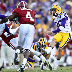 November 6, 2010; Baton Rouge, LA, USA;  LSU Tigers kicker Josh Jasper (30) kicks a field goal during the second half against the Alabama Crimson Tide at Tiger Stadium. LSU defeated Alabama 24-21.  Mandatory Credit: Derick E. Hingle