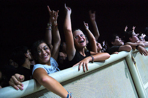 Fans front row at concert in Concrete Street Amphitheater in Corpus Christi, Texas.