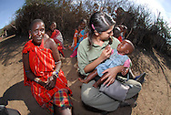 Foreigner expresses love and preocupation for a local baby. Masai Mara tribe around the Masai Mara National Park. Kenya. East Africa.
