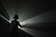 "© Licensed to London News Pictures. 29/01/2013. London, UK A woman moves in the light of Anthony McCall's ""You and I, Horizontal (2005) a solid light installation. Press preview of ""Light Show"" at the Hayward Gallery at the Southbank Centre in London today 29th January 2013. The exhibition runs 30th Jan-28th Apr 2013. Photo credit : Stephen Simpson/LNP"