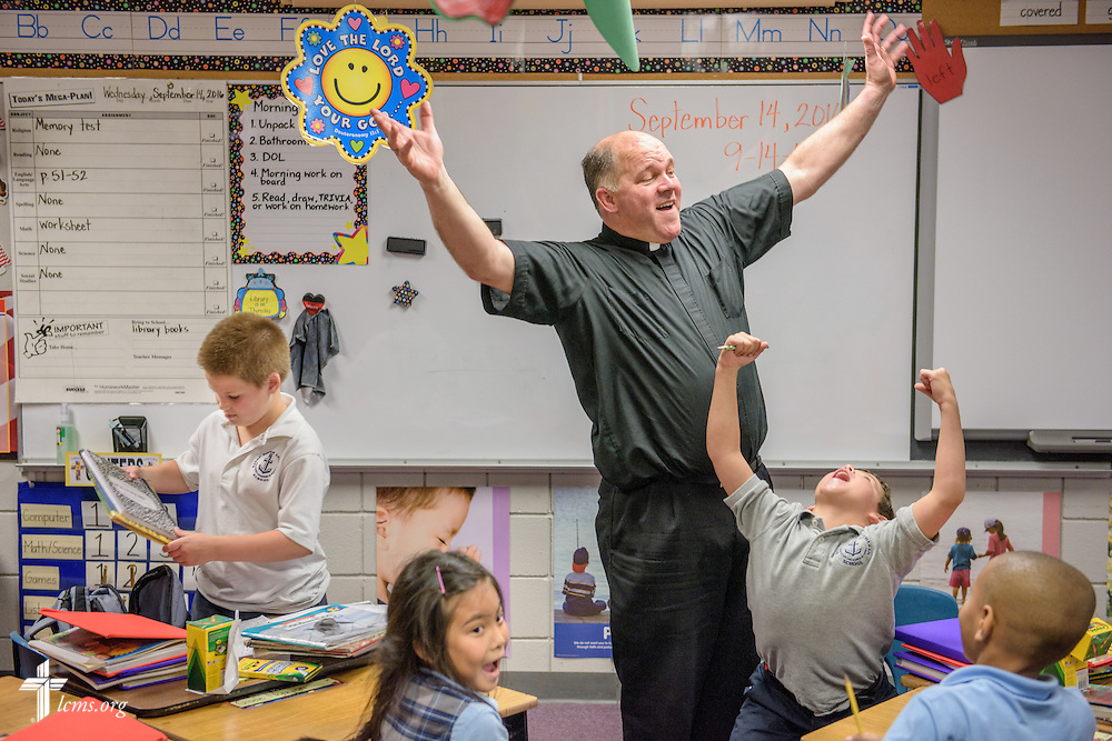 The Rev. David Buss, senior pastor at Trinity Lutheran Church, Baton Rouge, La., quizzes students on the Ten Commandments while he visits a classroom at Baton Rouge Lutheran School, a part of the church, on Wednesday,  Sept. 14, 2016, in Baton Rouge. A significant number of families with children at the school were affected by the August flooding. Grant money from LCMS Disaster Response is helping keep the children in the school while families face economic hardships. LCMS Communications/Erik M. Lunsford