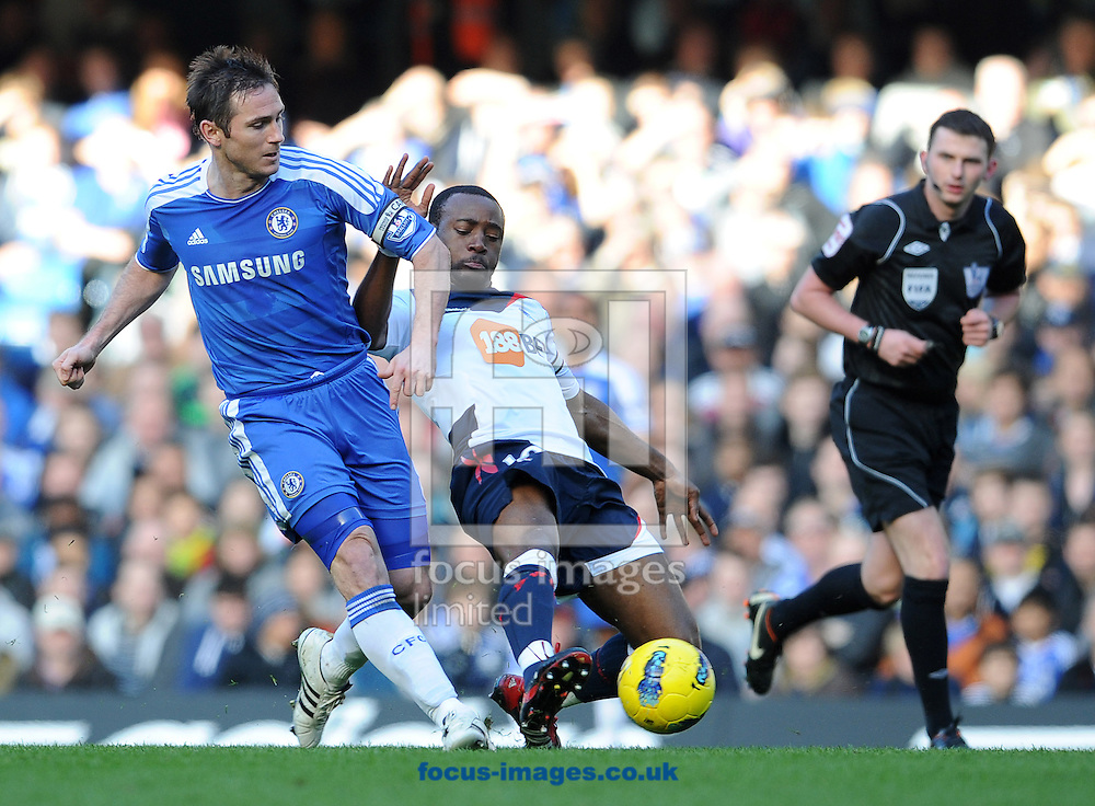 Picture by Andrew Timms/Focus Images Ltd. 07917 236526.25/02/12.Frank Lampard of Chelsea and Nigel Reo-Coker of Bolton Wanderers during the Barclay Premier League match at Stamford Bridge stadium, London.